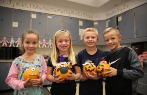 Meadow's Edge students with their decorated pumpkins at their Fall party.